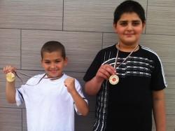 Двама от Сунг Ри шампиони при децата
